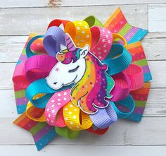Unicorn Hair Bow Unicorn Headband Unicorn Party Favor Unicorn costume Unicorn Birthday Rainbow Unicorn Bow Colorful Unicorn Bow Unicorn Horn Thank you for looking! This listing is for ONE Loopy Hair Bow (3,5-4) All measurements are approximate. All ribbon ends are heat sealed to