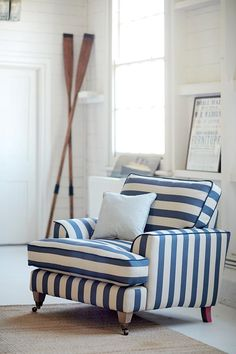A beautiful armchair in blue and white stripes, filling in this nautical theme space beautifully. Image by DFS Furniture.