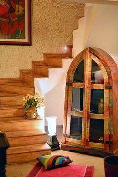 A reclaimed wood cathedral design bookshelf from Ra Lifestyles Bookshelves, Bookcase, Old Furniture, Decorating Blogs, Accent Pieces, Cathedral, Hardwood, Minimalist, Stairs