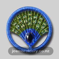 Lucky Peacock - Dorset Button Brooch In some cultures the peacock is considered to bring good luck. This stylised peacock brooch constructed on a Dorset-style button. Incorporating silk threads, beads and metallic threads. Button Image, Button Art, Button Crafts, Diy Buttons, How To Make Buttons, Vintage Buttons, Dorset Buttons, Good Luck To You, Passementerie