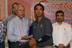 Mr. Liaqat KCCA Zone IIV giving Shield to Ameer Ahmed
