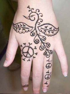 arabic mehndi designs | love the simple peacock design, but would replace the peace symbols with flowering