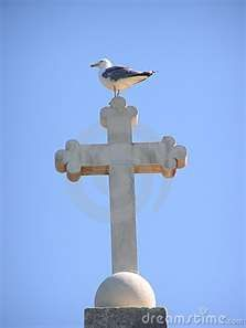 Cross with a sea gull sitting on it