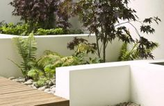 white walls + decking + stones