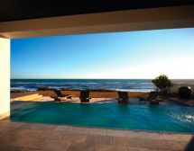 Infinity pool with lowered deck and ocean views (Dream Pools)