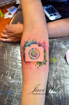 Watercolor Camera.  Tattooed by @Javi Wolf