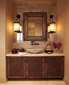 Cher's Hollywood Penthouse – Detail of the powder room sink with a porcupine quill mirror, antique Indian marble sink and an 18th century Tibetan accessories – © Martyn Lawrence-Bullard Design