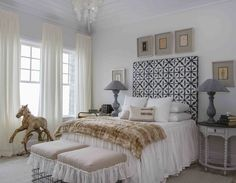 Daughter Rebecca's bedroom is designed around her love for horses, and includes an antique horse from Belgium that sits in front of her windows. Headboard is a Schumacher (fschumacher.com) batik fabric that set the tone for the rest of the room.