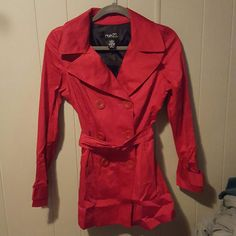 Red Pea Coat Red Pea coat with belt and double row of buttons. It's much cuter than the pictures show. Machine washable. Can be ironed, and will probably need it. It's in excellent condition other than being wrinkly. Rue 21 Jackets & Coats Pea Coats