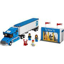 """LEGO City Set #7848 Toys R Us Truck by LEGO. $45.99. Delivery truck measures 39 cm. Includes 3 minifigures: truck driver, boy, and sales girl. Delivery truck features trailer, opening back and side doors and 3 LEGO boxes Toys 'R' Us shop features a toy car, hovercraft, teddy bear, and barrel filled with toys (15.5"""") long"""