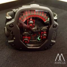 Something BIG and CHUNKY for this afternoon. Urwerk UR-110 black and red with titanium case and platinum bezel.
