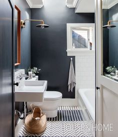 Designer Sophie Burke went with Farrow & Ball's Off-Black (57) to bring a touch of drama to this light-filled bathroom. | Photo: Janis Nicolay