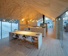 Reiulf Ramstad Architects, RRA, Norway, V Lodge, pine-clad architecture, pre-patinated wood, playroom, Buskerud, Al, microclimate, cabin, Scandinavian architecture, minimalism, minimalist cabin, gable architecture, untreated plywood, plywood, glazed end wall,