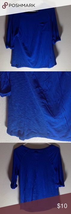 Size M woman' Blue shirt with pocket. Royal blue shirt with front pocket and fold over arm cuffs. Approx 24 inches from the back of the neck to the bottom.  Armpit to end of sleeve is approx 7 inches. Tops Tees - Short Sleeve
