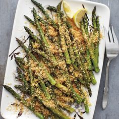 Roasted Asparagus with Lemony Breadcrumbs - Roasting asparagus at a high temperature concentrates its flavor and guarantees a tender -- but not mushy -- texture. To ensure crunchy crumbs, sprinkle them on just before serving.