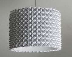 This DIY pendant light is made from faceted folded paper (fortune tellers) attached to a plain drum shade. The result is a stunning contemporary light. Hanging Lamp Shade, Drum Shade, Lamp Shades, Light Shades, Hanging Lights, Diy Luz, Le Manoosh, Diy Drums, Sphere Light