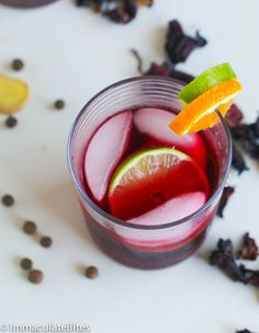 Sorrel Drink -Spiced up Drink that is enjoyed in Jamaica, Trinidad and throughout the Caribbean during the Christmas Season Jamaican Sorrel Drink Recipe, Beverages, Drinks, Orange Juice, Trinidad, Spice Things Up, Spices, Favorite Recipes, Vegetables