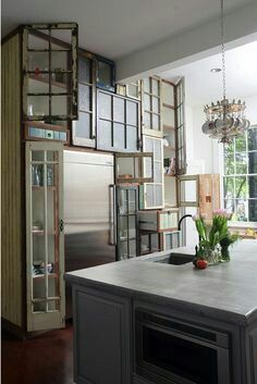 Old windows as cupboard doors... Not sure I like it quite as eclectic as  this but an interesting concept.