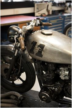 Vintage look cafe racer - I like the raw metal look of this gas tank with the painted numbers