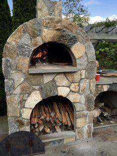 Amerigo outdoor pizza oven with natural stone veneer.