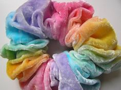 Scrunchys... honestly hated them when i was little and i still do but they were still kinda cool. just not for my hair...
