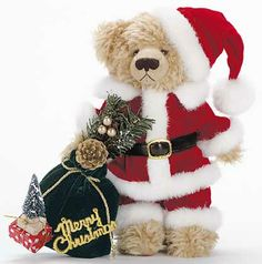 Cute Christmas teddy bear decorated in Santa Claus dress and hat