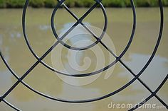 Water as seen trought ornamental iron circles in the Venetian lagoon.