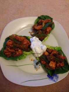 Step 2 chicken fajitas cambridge style! Chicken allowance with paprika, chilli powder and chilli flakes all mixed together 1 spring onion shredded, quarter of a green pepper All fried in a little water Served in 3 baby gem lettuce leaves And my version of sour cream, 2 tbsp 0 fat youghrt, some chipped fresh chives, 1 spring onion and fresh black pepper Was amazing!