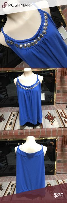 "Michael Kors beaded tank! XL This is a stunning blouse. One of the beads is loose, such an easy fix, two minutes if you sew. It is an XL. It's 95% rayon and 5% spandex so there is stretch. Armpit to armpit is 21"" From the top of the strap to the bottom of the blouse is almost 28"". Please forgive an inch either way, for this blouse does have stretch.  Purchased from Nordie's. TV way higher at $50. Thanks! Michael Kors Tops Tank Tops"