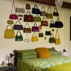 vintage purse display above bed. Would thi s look good if not using all vintage purses?