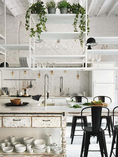 Rustic kitchen in a Barcelona apartment with white painted brick walls