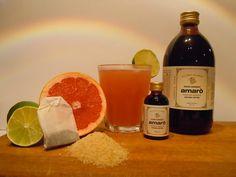 KURA TIME ,coktail analcolico ingredienti: succo pompelmo, succo arancia rossa, succo di lime, tè alla pesca, Amarò.