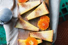 Mandarin milk tart — This South African twist on a custard tart is made with a sweet milk filling and a sprinkling of cinnamon. Fun Desserts, Delicious Desserts, Melktert, Custard Tart, Cinnamon Cake, Tart Shells, South African Recipes, Gifts For Cooks, Tart Recipes