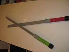 diy plastic ninja sword! Maybe Mulan themed colors for the handles instead of red & green.