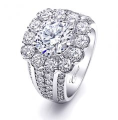 A stunning #engagement #ring featuring a cushion-shaped halo and four rows of diamonds on the band.