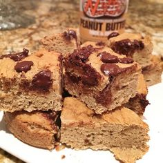 Peanut Butter Chocolate Chunk Squares made with Krush Thick n Creamy protein peanut butter!