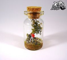 Quirky, cute mini world in a bottle. This one features Harry, he has seen something that he doesn't like! Standing back, scared... I wonder what he has seen
