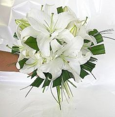 I love me a good white lily wedding bouquet. Tiger Lily Bouquet, White Lily Bouquet, Lily Bouquet Wedding, Bridesmaid Bouquet White, Tropical Wedding Bouquets, White Wedding Bouquets, White Weddings, Stargazer Lily Wedding, Stargazer Lilies