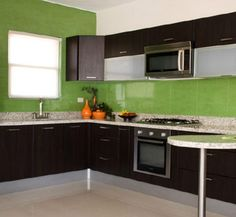 Great use of bold colored tile: Modern Kitchen with appliances