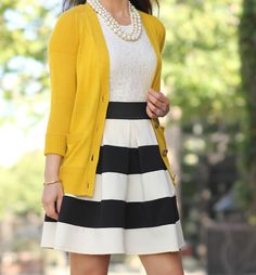 Black and white striped skirt, lace top, mustard cardigan, triple strand pearl necklace, gold bracelet // Click the following link to see outfit details and photos:   http://www.stylishpetite.com/2015/03/modcloth-stripe-it-lucky-skirt-mustard.html