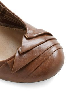 Brown leather wedge? Day standard. This one stands out with a cute folded toe. Tale as Fold as Time Wedge, #ModCloth