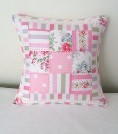 Handmade patchwork cushion made with pink Cath Kidston fabrics