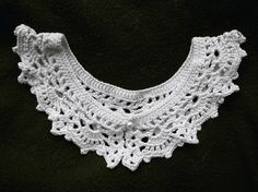 off-white crochet collar...  made this one for my sister, so she could wear it during concerts!