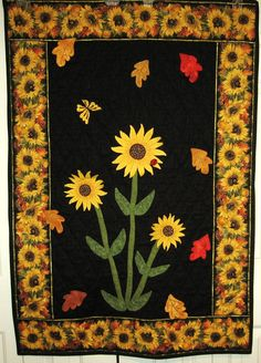 Sunflower wall hanging - Designed and quilted using double sided leaves and flowers, which I then tacked on, so they appear to be floating on the quilt.