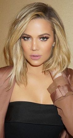 Khloe Khardashian medium shoulder length hair straight lob collar soft blonde balayage  dark roots side part