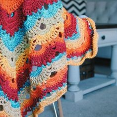 Crochet Virus Blanket made with Caron Cakes yarn in the Rainbow Sprinkles color way by @Playasuave on instagram.