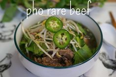 pho rare beef - broth simmered for a few hours until the beef is tender, flavored with star anise, cardamom, coriander, cinnamon, onion, and ginger. finished with rice noodles, topped with thinly-sliced rare beef, raw onions, scallions, and lots of sprouts, cilantro, culantro, thai basil, jalapeno slices, and a bit of lime juice
