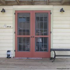 Paired wood screen doors for double French doors in St. Petersburg, FL