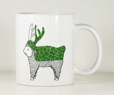 """Ce cerf vert est une des tasses illustrées par Vanessa Gandar. Les """"animaux imaginaires""""  sont tous plus jolies les uns que les autres. La série se co"""