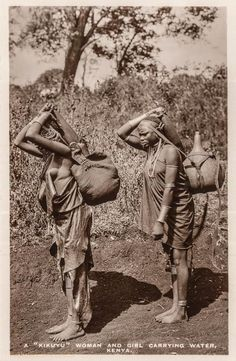 "A ""Kikuyu"" woman and girl carrying water."